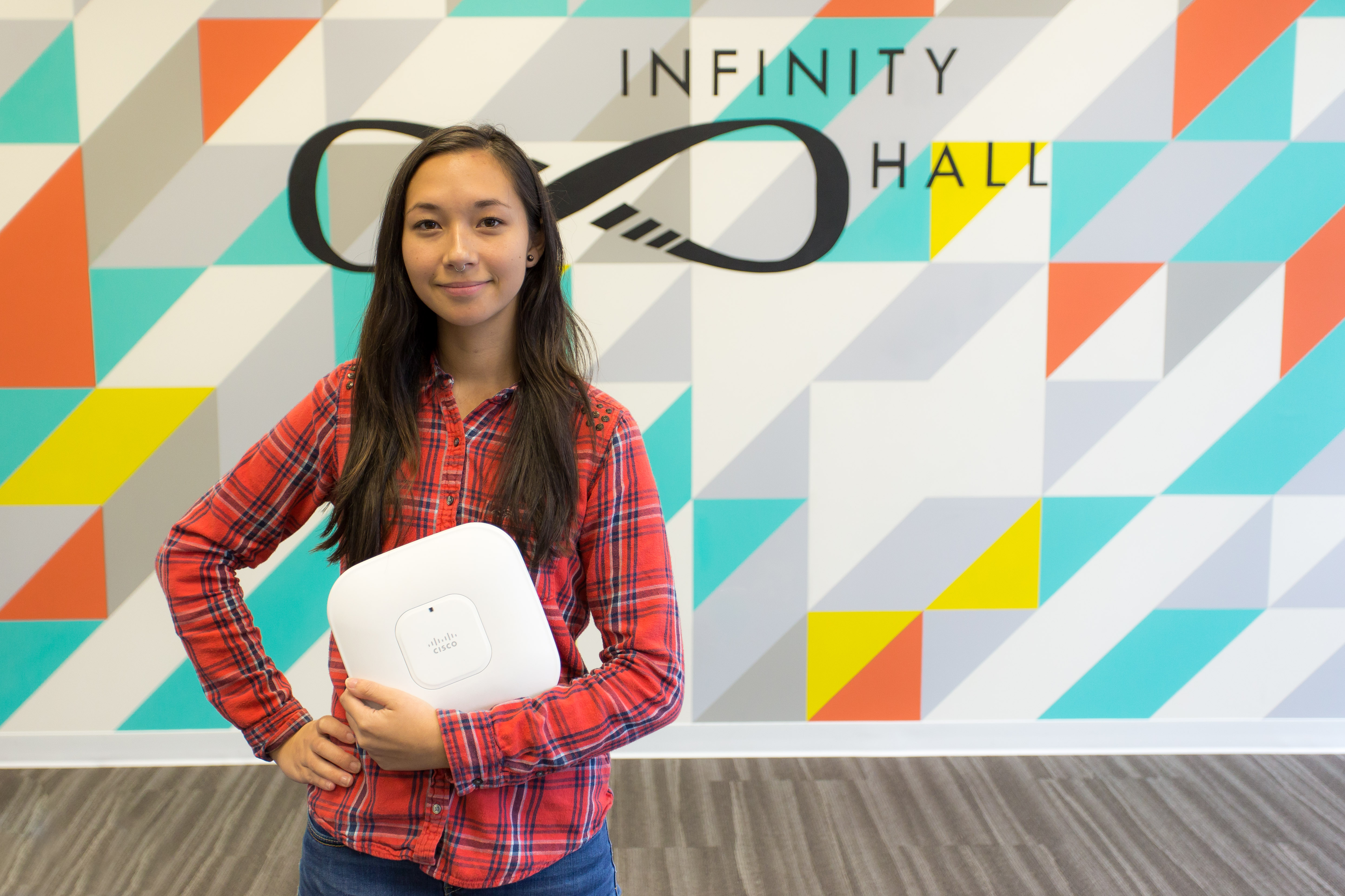 Annie holding a white router at Infinity Hall