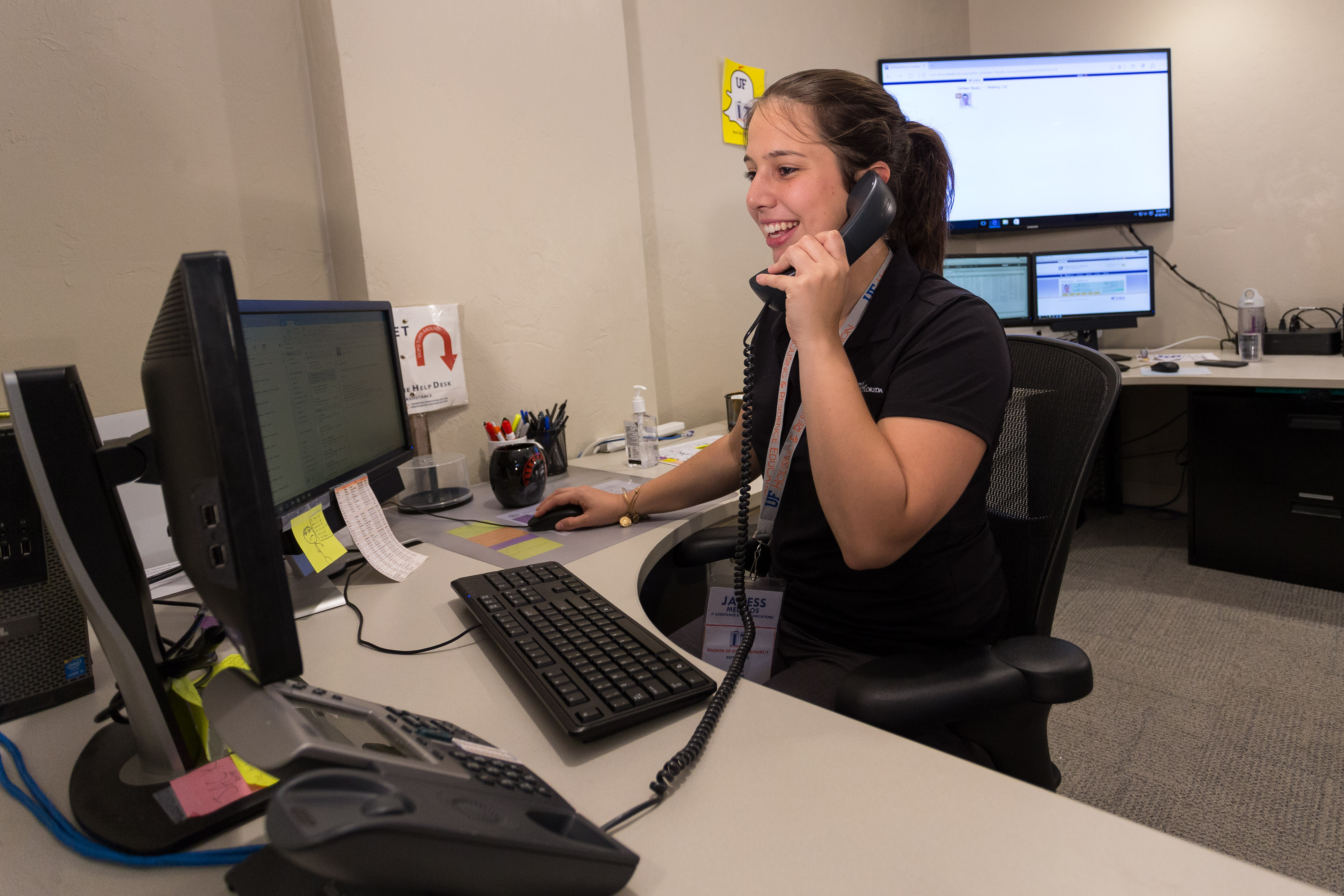 student answering phone calls at DH Net help desk